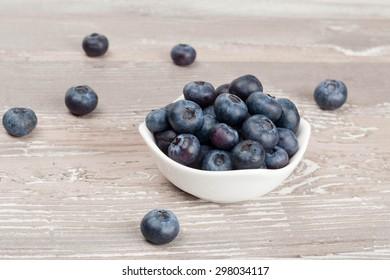 white bowl of fresh blueberries horizontal