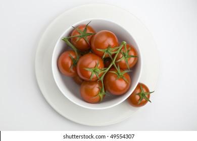 White bowl full of vine tomatoes