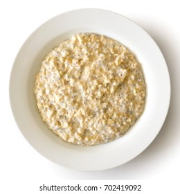 White bowl of oats porridge with chia seeds isolated on white from above.