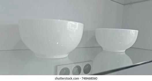 White Bowl on glass shelf