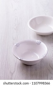White bowl on wooden table