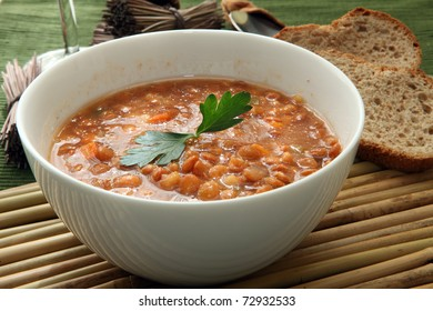 a white bowl of red lentil soup