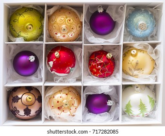 White box with colorful ornate christmas balls on white background