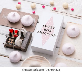 White box mockup next to different sweets on white table