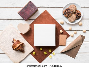 White box mockup next to sweets. Top view.