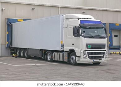 White Box Semi Trailer at Warehouse Loading Bay Dock