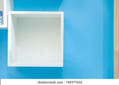 White box shelf isolated on blue background.