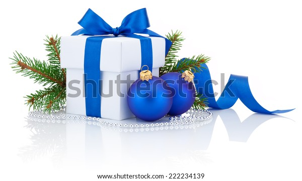 White box tied blue ribbon bow, pine tree branch and two christmas balls Isolated on white background