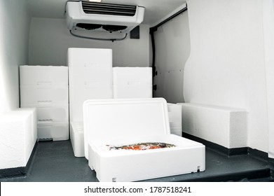 White boxes with ice and fish loaded in van for transportation