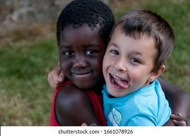 White boy and black boy hugging