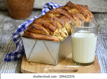 White bread with cinnamon on the rustic background.
