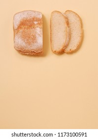 White bread and slices of bread over yellow background