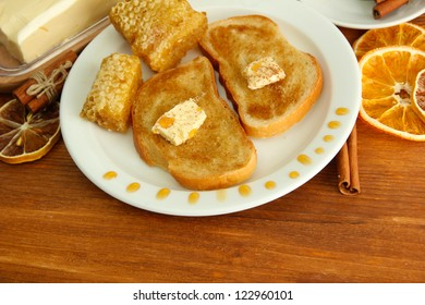 White bread toast with honey and cup of coffee on wooden table