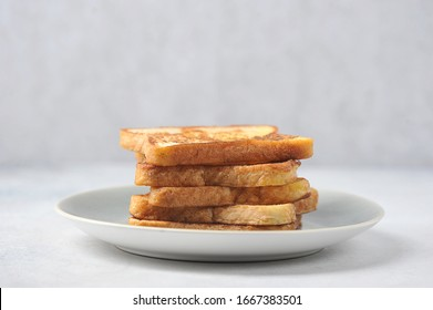 White bread toasts on a plate. Light background. Close-up. Free space for text.