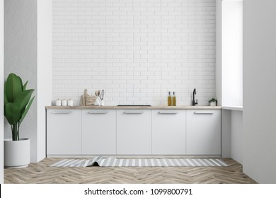 White brick kitchen interior with white countertops and a potted plant near the wall. A front view. 3d rendering mock up