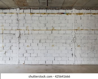 White brick wall in an abandoned building