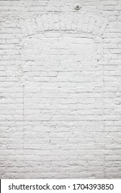 White brick wall and arch