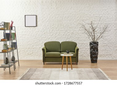 White brick wall background, green sofa and home object.