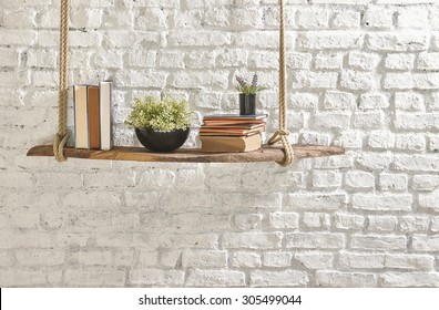 white brick wall bookshelf and flower