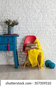 white brick wall decor and red chair