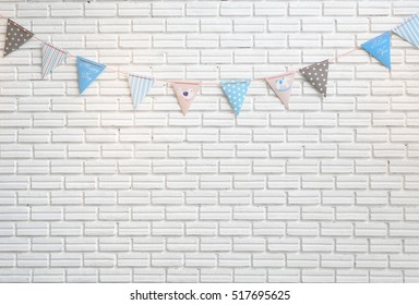 White brick wall decorated by colorful cartoon flag for children baby shower party or children bedroom