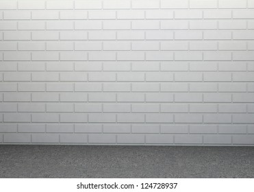 White brick wall and dirty concrete floor