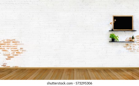 White brick wall and empty wood floor.