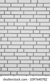 white brick wall with gray grouting, vertical background texture pattern