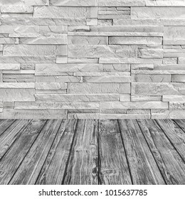 White brick wall and gray wooden floor