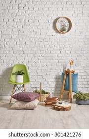 white brick wall interior, green chair with frame concept