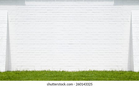 White brick wall made of bricks. Place for text, on a sunny day