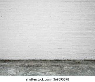white brick wall with moosy floor indoor empty nobody