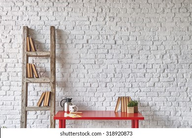 white brick wall red table interior with old stairs