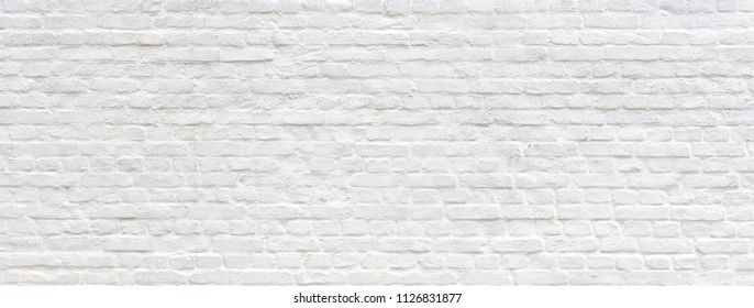 White brick wall texture panoramic . Home and office design backdrop. Painted bricks wall