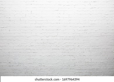 White brick wall with thick uneven joints.