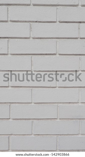 White brick wall useful as a background - vertical
