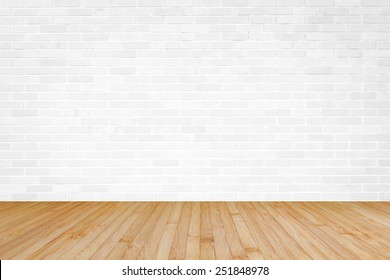 White brick wall with wooden floor copy space background of interior decoration
