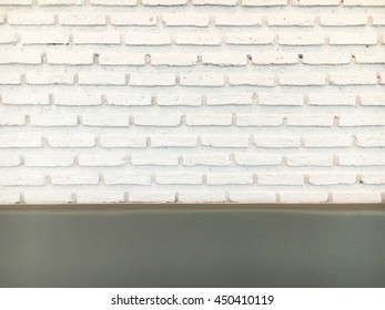 The white bricks wall with sofa or mirror edge for background.