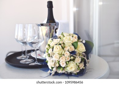 White bridal bouquet and champagne