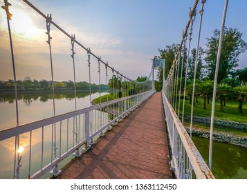 White bridge in the park at the Nong Prajak lake , Udon Thani Province in Thailand.
