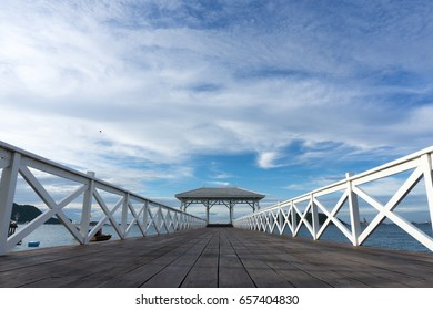 white bridge walk way go to the pavilion on the sea with blue sky and clouds
