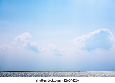 White bright fluffy clouds on a blue sky above the sea. Anapa, Russia