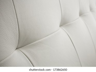 White bright leather background or texture with sewing.