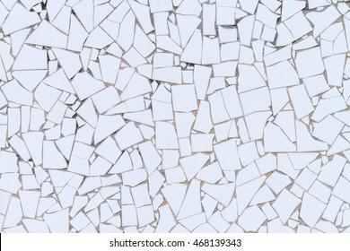 White broken tiles wall texture.