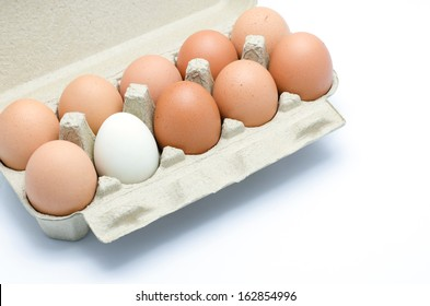 white and brown eggs in a carton package
