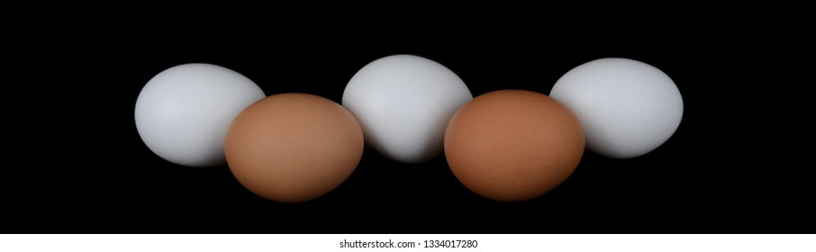 White and brown Eggs Isolated On Black