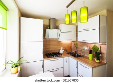 White and brown interior with green accessories foe small kitchen