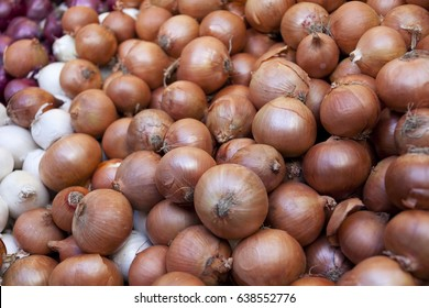 White and Brown Onions on a market stall. Full Frame. Healthy food.