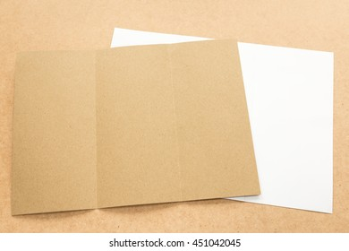 White and brown paper note on business wood desk with copy space.