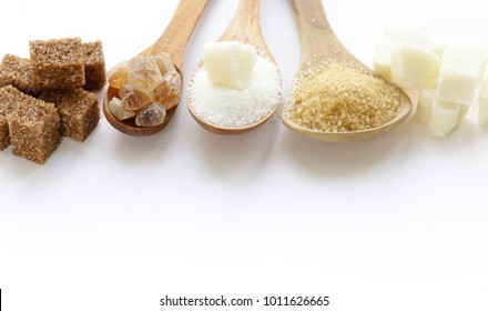white and brown sugar sand and refined sugar
